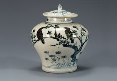 (Korea) White Porcelain Jar in under glaze Cobalt-Blue. Joseon dynasty, Korea. ca late 15th century to 16th century CE. National Treasures #170.  H 16.5cm.  National Museum of Korea. 백자 매화 대나무 새무늬 항아리. 국보 170호.
