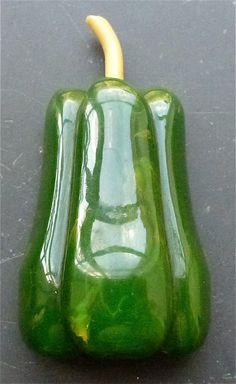 Rare bakelite pepper with celluloid stem 2.5 x 1.5 in (3/4 in thick).  Price: $1,650.00