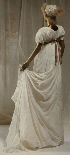 **The skirt of this dress is trimmed with five rows of ribbon, rather than any expensive embroidery.** (great idea for decorating without knowing how to embroider!) The headdress here is an interesting combination of satin ribbon and spangled fabric.