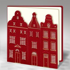 The Christmas card is made of high quality bordeaux paper. The bordeaux cover has laser cut  design of old houses. Some elements are embossed and have hot stamp gold foil.The insert is mat ecru. The envelope is included.