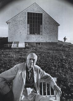 """Edward Hopper at his Cape Cod home, with his wife Josephine in the background, 1960 """"That's what we do…He sits in his spot and looks at the hills all day, and I look at the ocean, and when we meet there's controversy, controversy, controversy."""" Josephine Hopper, Edward Hopper's wife. [via Smithsonian Magazine - July 2007]"""