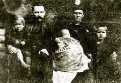 """This tattered photograph is an early image of William Anderson """"Cap"""" Hatfield, second son of Devil Anse and Levicey Hatfield, and his wife, Nancy """"Nan"""" Smith Hatfield, with their children Coleman A., Levisa, and Shep. —(Photo from Dr. Coleman C. Hatfield Collection, courtesy of Dr. Arabel E. Hatfield)"""