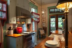This wouldn't work in my house, but would love to live in a cottage with a kitchen like this.--Fish Camp Beach Cottage - beach style - kitchen - by Historical Concepts