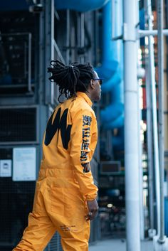 Men's water resistant yellow techwear jumpsuit with full central zip opening on front and MACHINA resistor schematic symbol and micrographics prints with multifunctional pockets. Sparkly Jumpsuit, Yellow Jumpsuit, Wedding Jumpsuit, Hazmat Suit, Grey Fashion, Street Fashion, Fall Fashion, Fashion Trends, Fashion Jackson
