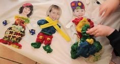 This looks so fun - Photo of child's head and neck - a paper body and lots of collage materials including playdoh!