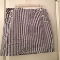 Tommy Hilfiger Seersucker Skirt This striped seersucker skirt features anchor buttons and pockets. Make an offer! Tommy Hilfiger Skirts Mini