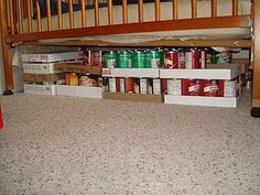 Under the crib or bed storage. Just cover with a dust ruffle to hide your food.