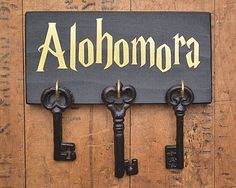 Alohomora An excellent key holder for Harry Potter fans! Small 6.9 x 3.5 solid wood with permanent vinyl lettering Includes either a Command Maybe something for https://Addgeeks.com ?