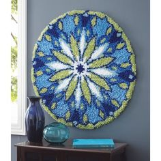 My favorite source for arts and crafts:  True Blue Mandala Latch Hook Rug Kit