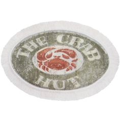 """Blonder East Harbor Crab Decorative Rug by BigKitchen. $15.99. Latex foam backing for non-slip use. Red crab enclosed by the words """"THE CRAB HUT"""". Machine washable. 100% nylon with ivory fringe edging. Fantastic as a bathmat for crab and seafood lovers, or even in an entry way to your home, this decorative rug features a faux weathered sign design with the phrase """"THE CRAB HUT"""" around the edges and a red crab in the middle. This design paired with the ivory fr..."""