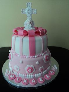 Girl Baptism Cake.  White Chocolate cake, raspberry filling, white chocolate buttercream. Covered in fondant and fondant accents.  Precious Moments figurine used as cake topper.