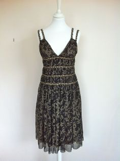 Chanel Black tulle embroidered dress via The Queen Bee. Click on the image to see more!