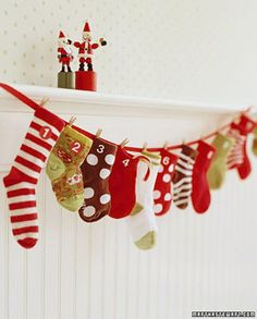 Diy advent calendar- Buy a bunch of Christmas socks and clothes pin them to some ribbon. Love it!