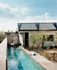 beautiful concrete house with lap pool