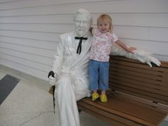 Colonel sanders statue with little girl | ... KFC - Sanders Cafe. Greta really loved the Colonel Sanders statue