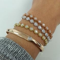 These diamond studded stack-able bracelets are available in Rose, Yellow, and White gold! Perfect to mix and match!