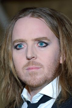 Tim Minchin.... australian, hilariously wickedly evil, and a ginger....(it's okay, I can call him that... I'm a ginger too.)
