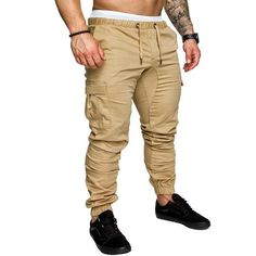 Autumn Men Pants Hip Hop Harem Joggers Pants 2020 New Male Trousers Mens Joggers Solid Multi-pocket Pants Sweatpants M-4XL Brand Name: VOLGINSPant Style: Harem PantsWaist Type: MidFront Style: FlatMaterial: SpandexMaterial: CottonFit Type: RegularGender: MENItem Type: Full LengthStyle: Hip HopThickness: MidweightFabric Type: BroadclothLength: Full LengthClosure Type: Elastic Waist Mens Jogger Pants, Men Trousers, Gym Pants, Cargo Pants Men, Mens Sweatpants, Harem Trousers, Sport Pants, Harem Sweatpants, Sweatpants Style