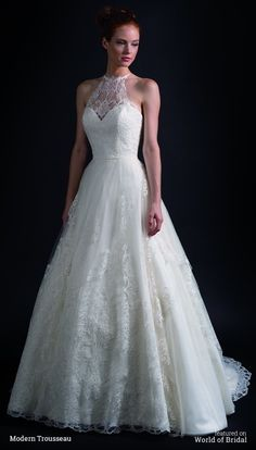 Embroidered European tulle gown featuring full asymmetrical cut skirt and halterneck bodice with a low back.#wedding #dresses #bridal #gown #dress