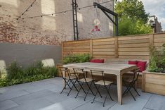 Teak outdoor dining set in our custom-designed backyard garden in Brooklyn. Patio is thermal bluestone, and fence is modern horizontal cedar with a built-in bench and planters. Outdoor Dining Set, Outdoor Furniture Sets, Outdoor Decor, Patio, Backyard, Built In Bench, Cedar Fence, Amazing Gardens, Design Projects
