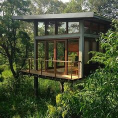 A cabin in the forest, grab my beanbag because that balcony needs sitting on!     Cabin by Geoffrey Bawa Architect     Share your cabin adventures with us : #cabinlife