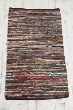 Multi Leather Rag Rug--love the idea of recycling leather.  But...most leather items go for a premium at thrift shops.  Old worn out leather upholstery would be the best but how to obtain it before someone throws it out?