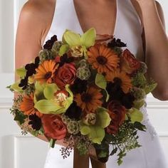Autumn nosegay combining beautiful rustic gerbera daisies and roses, accented by green cymbidium orchids.