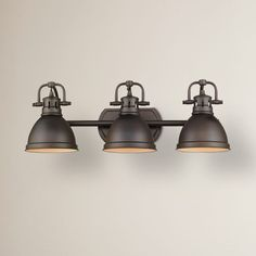 Features:  -Bowdoinham collection.  -Fixture body and shade are a warm, rubbed bronze finish.  -Simple and classic silhouette.  -Contemporary style with industrial feel.  -Provides task light over a v