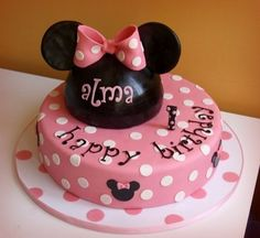 minnie mouse cake...I don't like the bottom tier but I like the mouse ears with name on top
