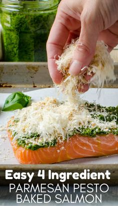 Easy 4 Ingredient Parmesan Pesto Baked Salmon Want a quick and easy, healthy oven baked salmon recipe? This is the BEST with only 4 ingredients and 20 minutes, this simple, homemade dinner is on the table. Perfect for Lent or any busy weeknight. Pesto Salmon Baked, Baked Salmon Recipes, Parmesan Salmon, Fish Dishes, Seafood Dishes, Fish And Seafood, Salmon Dinner, Cooking Recipes, Healthy Recipes