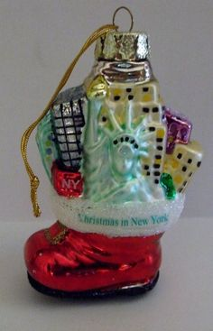 Hanging a Christmas Ornament of a red stocking with the The Statue Of Liberty featured is a great way to bring your love of #NYC into your home this #Holiday season!