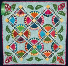 """""""Carnivale"""" by Nancy Rink. New York Beauty blocks with flying geese borders and leafy applique. 2010 Quilt Show, Cotton Patch Quilters"""