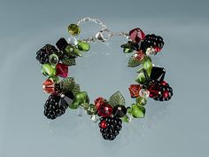 Handmade Glass Blackberry Bracelet with lifelike glass blackberry beads. A wonderful gift for your cook, foodie, gourmet or gardener.  $350.   By Elizabeth Johnson.
