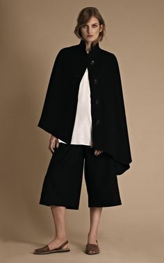Cashmere-mix cape, £149, shirt, £29.90, and wool and cashmere culottes, £39.90.