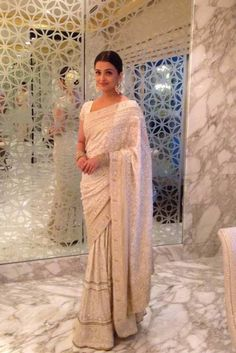 Aishwarya Rai Bachchan in an off whire saree in Chennai. #Bollywood #Fashion #Style #Beauty