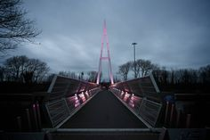 The Greystone footbridge lit in pink for Mother's Day 2017.