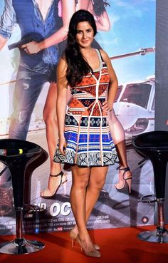 Katrina Kaif looks beautiful in a colourful printed DvF dress with nude pumps at the launch of 'Bang Bang' title track. Katrina Kaif Body, Katrina Kaif Hot Pics, Katrina Kaif Photo, Beautiful Bollywood Actress, Beautiful Actresses, Sleeveless Denim Jackets, How To Look Handsome, Italian Fashion Designers, Indian Celebrities