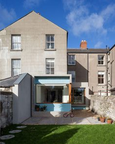 House extension by GKMP Architects includes a wooden window seat : I like the exterior cladding and the windows