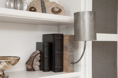 LIVING ROOM - Arteriors Sconce in Custom Designed Bookcase; Liepold Design Group LLC