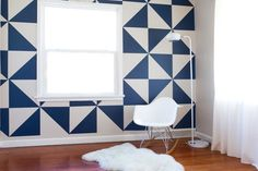 geometric wallpaper and eames' plastic molded rocking chair