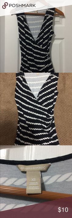 Banana Republic cotton tank Navy and white tank by banana Republic. Low-cut, crisscross with rouged sides. In great condition! Banana Republic Tops Tank Tops