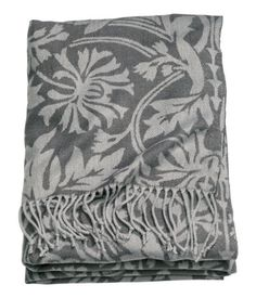 Throw in soft jacquard-weave fabric with fringe on short sides.