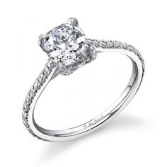 This Riviera cushion-cut diamond engagement ring features a partial micropave-accented band and prong setting in platinum. Ring from Jean Dousset.