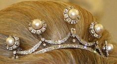 The Pearl button tiara (the buttons can be replaced by diamond stars).