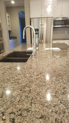 Giall Artic Countertops With Black Granite Composite Sink And Stone Faucet