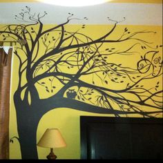 Tree mural! Instead of joy do family hang frames on branches