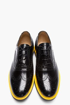 H BY HUDSON // Black High-Shine Leather Yellow-Trimmed Wingtip brogues 32271M049001 Low top patent leather wingtip brogues in black. Round toe. Tonal lace up closure. Signature perforated detail throughout. Contrast yellow welt. Grey rubber foxing. Leather upper, rubber sole. Made in United States. $260 CAD