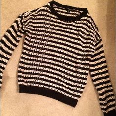 striped sweater medium black and white striped sweater. no rips, stains, or holes. rarely worn, great condition. Sweaters