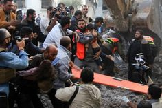 A Palestinian man carries the dead body of a child from the al-Dallu family out from the rubble after an Israeli missile struck a family home killing at least seven members of the same family in Gaza City on November Gaza Strip, Family Outing, November, Children, November Born, Young Children, Boys, Kids, Child