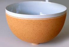 Per Rehfeldt, bowl in with a small base, thin porcelain with iron-slip, made on the wheel. Own studio Bornholm, Denmark 1991. H: 11. W: 17 cm.
